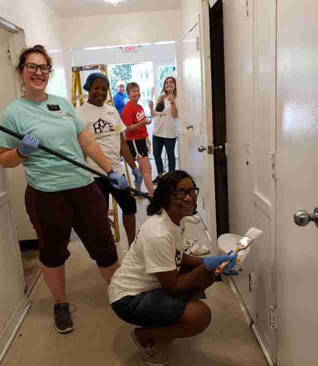 volunteers paint the wall at toco hills community alliance